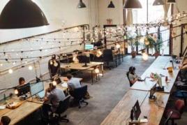 People on laptop in coworking space image