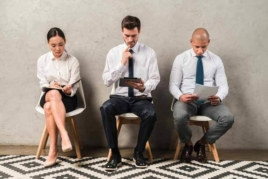 Three candidates waiting for a job interview image