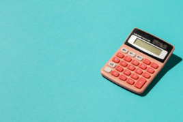 Calculator on blue background image
