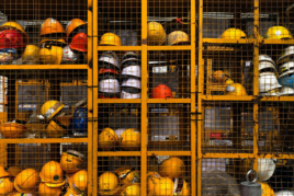 Construction helmets in cage for health and safety image