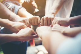 Group of people with hands together image