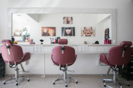 Hair salon with three empty chairs image