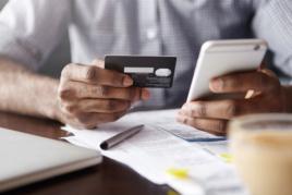 Man entering bank card details into phone image