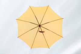 Open yellow umbrella image