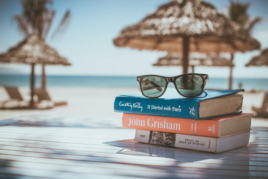Sunglasses and books on the beach during annual leave image