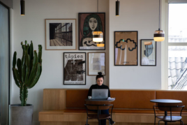 Woman with laptop sitting in cafe image